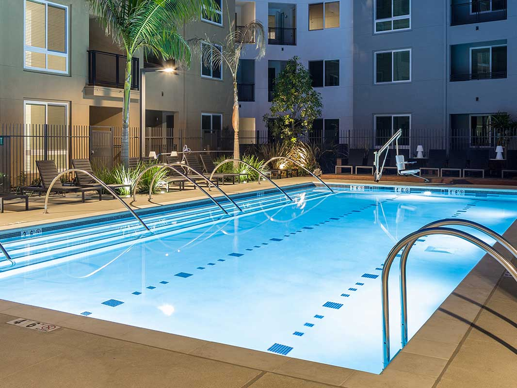 Luxury apartment pool lit at night