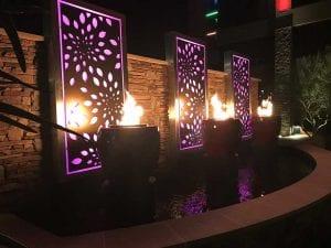 Purple light shining from fire water feature